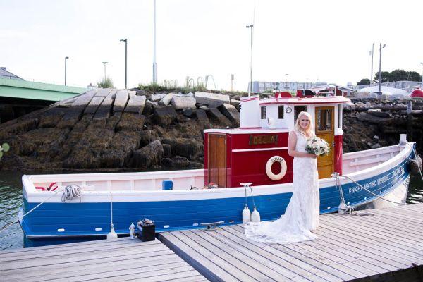 Maine Bride boarding boat to Wedding reception